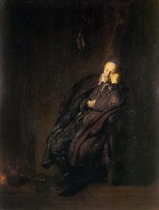 Old man asleep by a fire